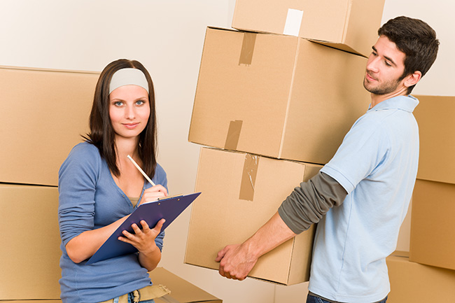 Inspect the moving boxes as they are carried inside your new home.